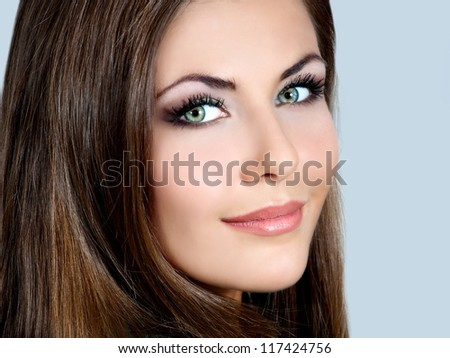 Beautiful woman with evening make-up and long hair - stock photo