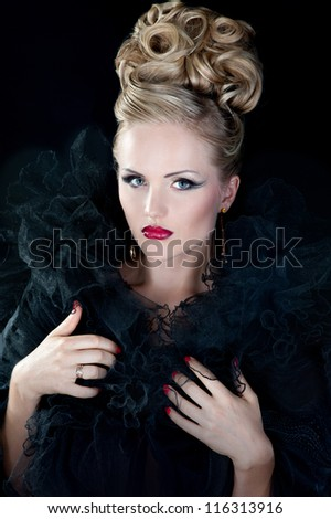 Beautiful woman with evening make-up and stylish hairstyle - stock photo