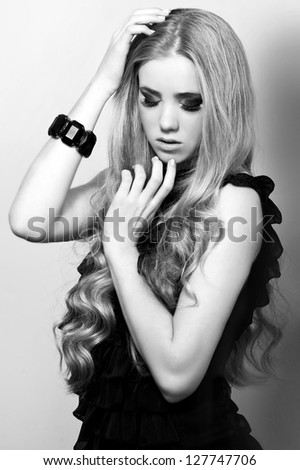 Beautiful woman with evening make-up. Jewelry and Beauty. Fashion photo. Black-and-white photo.