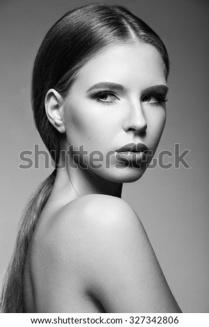 Beautiful woman with evening make-up,  long straight hair . Smoky eyes. Fashion photo. Black and White