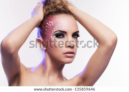 Beautiful woman with fantasy makeup on a white background - stock photo