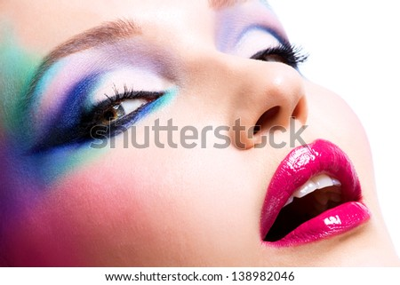 Beautiful woman with fashion bright makeup of eyes and sexy red lips - stock photo