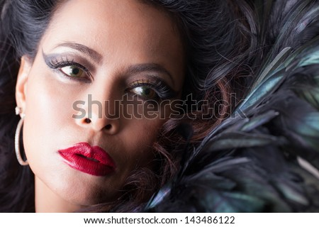 Beautiful  woman with Feathers and perfect red lips