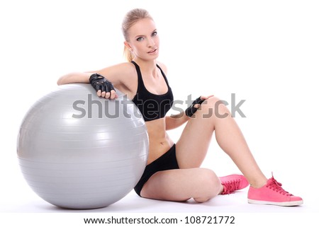 Beautiful woman with fitness ball over white background - stock photo