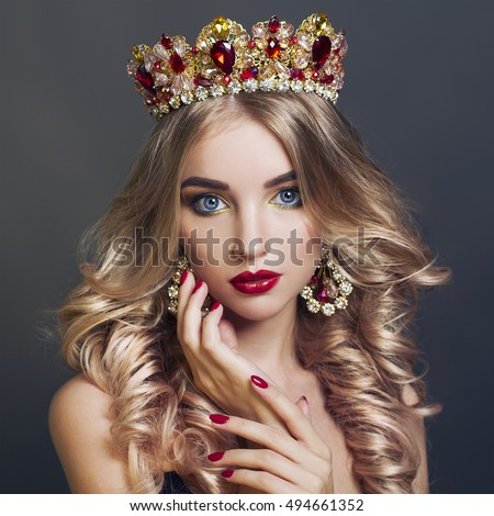 Beautiful woman with floral headband and bright makeup fashion portrait