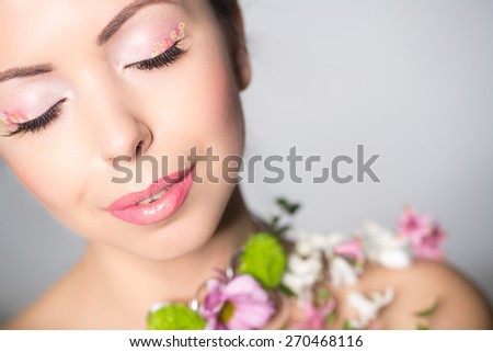 Beautiful woman with flowers on the showlder. - stock photo