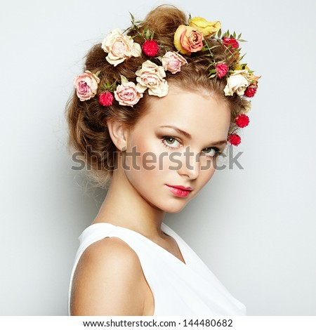 Beautiful woman with flowers. Perfect face skin. Beauty Portrait. Fashion photo