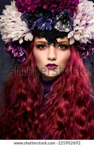 Beautiful woman with flowery headpiece - stock photo