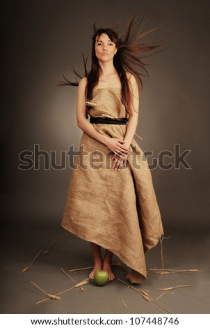 Beautiful woman with fluttering hair and wheat ears. Eco girl. - stock photo