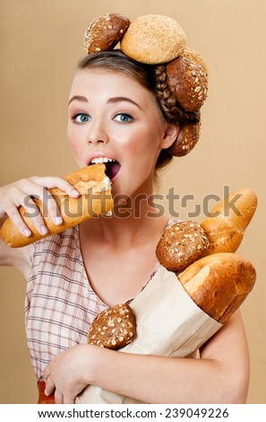 Beautiful woman with fresh fragrant bread. Crispy rolls. Bread Baking. - stock photo