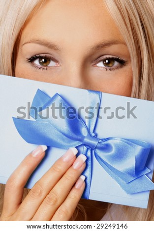 beautiful woman with gift. sexy girl holding a gift in packing - stock photo
