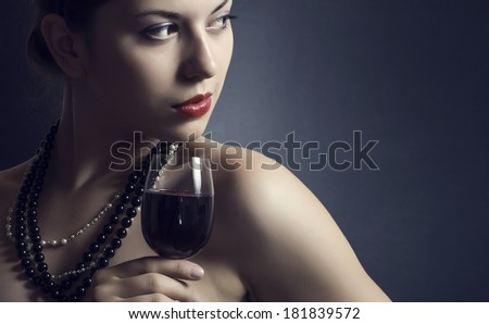 beautiful woman with glass red wine - stock photo
