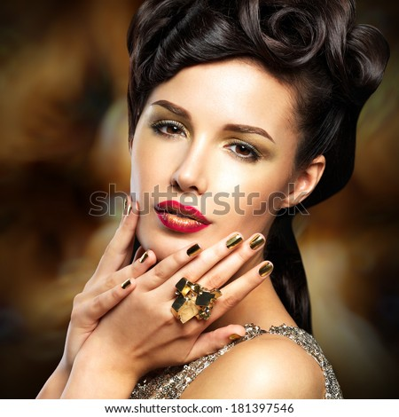 Beautiful  woman with golded nails and bright red lips  - stock photo