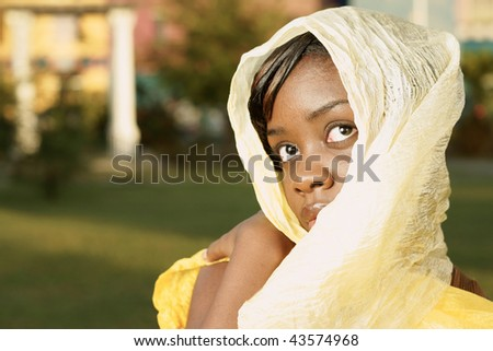 beautiful woman with golden head scarf with strong look