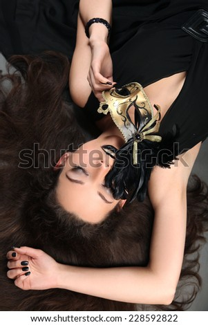 beautiful woman with golden mask - stock photo