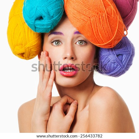 Beautiful woman with hair made of threads for knitting. Professional makeup. - stock photo