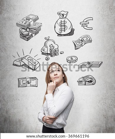 beautiful woman with hand on chin looking up and thinking about money, black pictures symbolizing money over her head. Concrete background. Front view. Concept of running into money. - stock photo