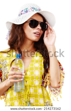 beautiful woman with hat and sunglasses drinking water