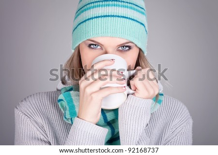 Beautiful woman  with hat drinking hot tea, concept-hot winter - stock photo