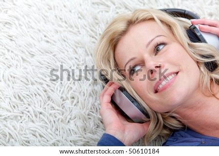 Beautiful woman with headphones listening to music - stock photo