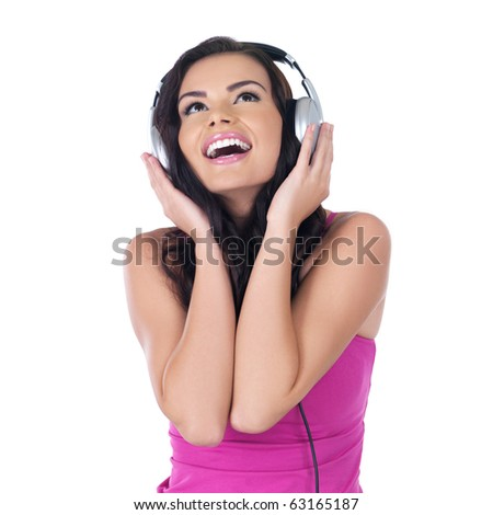 Beautiful woman with headphones, she is listen to the music - stock photo