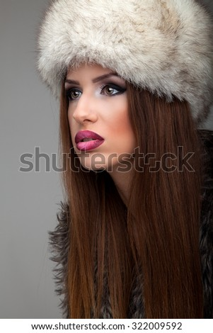 Beautiful Woman with Healthy Long brown Hair. Hairstyle. Beauty Glamour Fashion Model Girl Portrait. Perfect Skin and Makeup Natural Make up. Brown eyes and light pink lipstic - stock photo