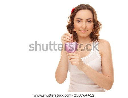 Beautiful woman with heart shaped toy isolated on white - stock photo