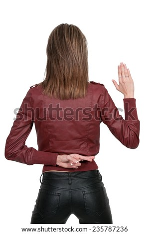 Beautiful woman with her fingers crossed behind her back - stock photo