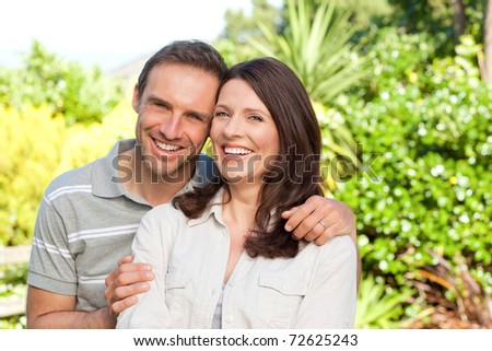 Beautiful woman with her husband in the garden