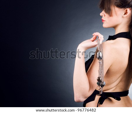 Beautiful woman with jewelry in hand. - stock photo