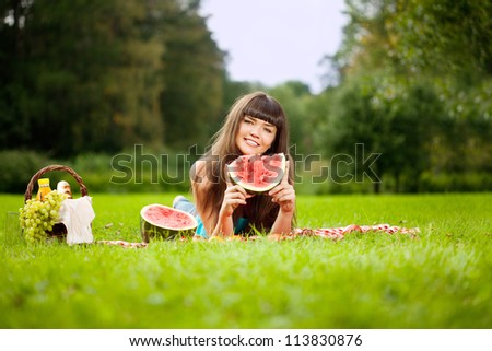 Beautiful woman with juicy watermelon in hands - stock photo