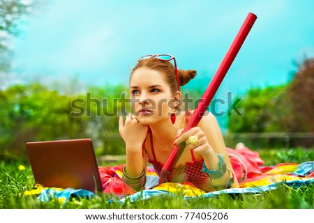 Beautiful woman with laptop - stock photo