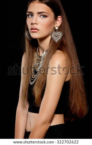 Beautiful woman with large earrings and necklace - stock photo