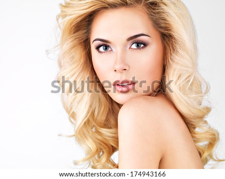 Beautiful woman with long blond curly hair.Isolated on white - stock photo