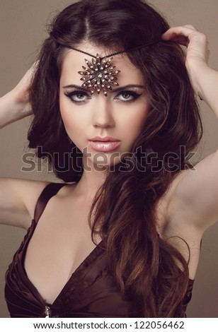 Beautiful woman with long brown hair. Fashion art photo. Beauty and Jewelry - stock photo