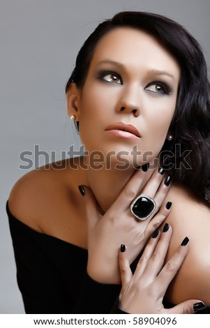 beautiful woman with long curly hair and black manicure in retro style, from 16 Bit RAW. - stock photo