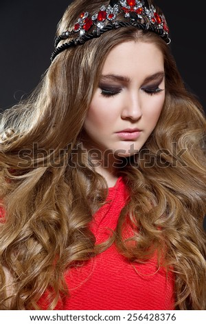 Beautiful woman with long curly hair and fashion makeup - stock photo