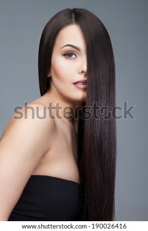 beautiful woman with long hair groomed