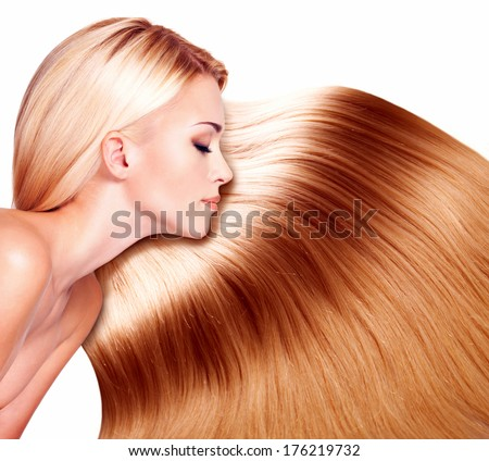Beautiful woman with long hair over white background - stock photo