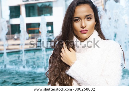 beautiful woman with long hair. Street fashion. Outdoors shot. horizontal - stock photo