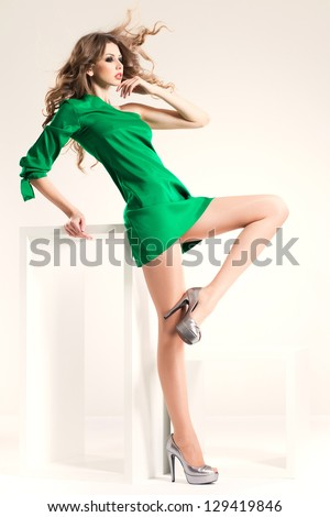 beautiful woman with long sexy legs and perfect body dressed elegant posing in the studio - full body - stock photo