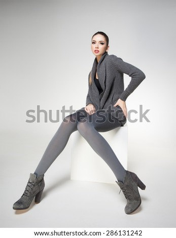 beautiful woman with long sexy legs dressed elegant posing - stock photo
