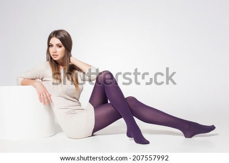 beautiful woman with long sexy legs wearing stockings posing in the studio - full body  - stock photo