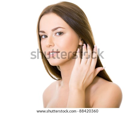Beautiful woman with long straight brown hair looking at camera, isolated on white background - stock photo