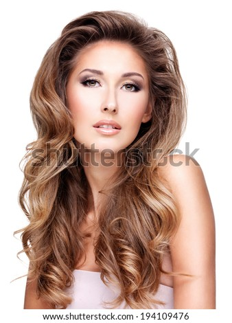 Beautiful woman with long wavy hair, isolated on white background - stock photo