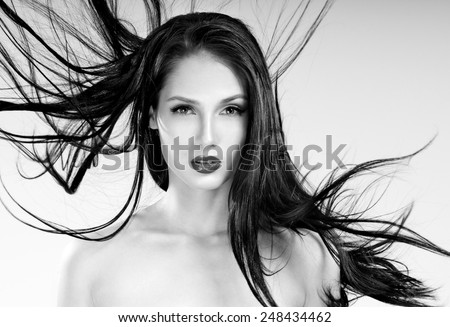 Beautiful woman with magnificent hair. Flying hair. - stock photo