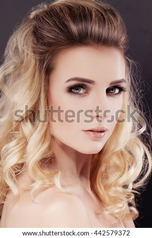 Beautiful Woman with Makeup and Wavy Permed Hairstyle