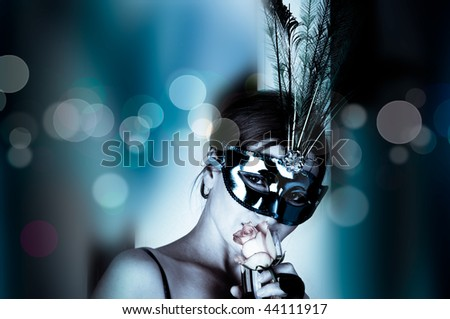 beautiful woman with mask and wine - stock photo