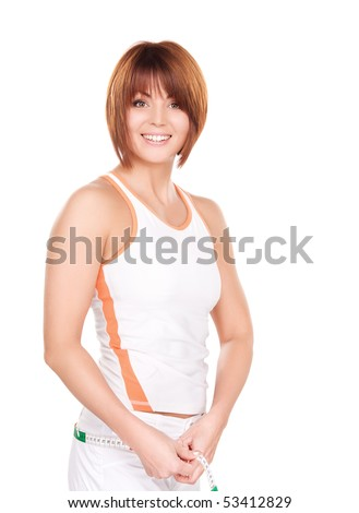 beautiful woman with measure tape over white - stock photo