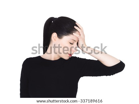 Beautiful woman with migraine. She has closed eyes and one hand on the forehead. studio photography - stock photo